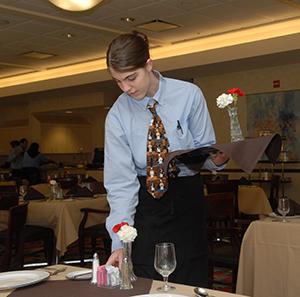 Server preparing for diners
