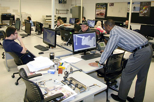 Roger Weekes (back) is the Lead Instructor and Dept. Coordinator of HFC's CAD Technology/Industrial Drafting Technology Program, which offers instruction in several different types of 3D Solid Modeling CAD software programs currently being used in industry.